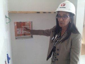 """Dr. Judith Campbell explains how a """"pass through window"""" will save time in Texas Children's Hospital 8-bed biocontainment unit, currently under construction.  Nurses can deliver supplies and medications to a patient room without having to don and doff the entire protective outfit and hood. Photo/Carrie Feibel"""
