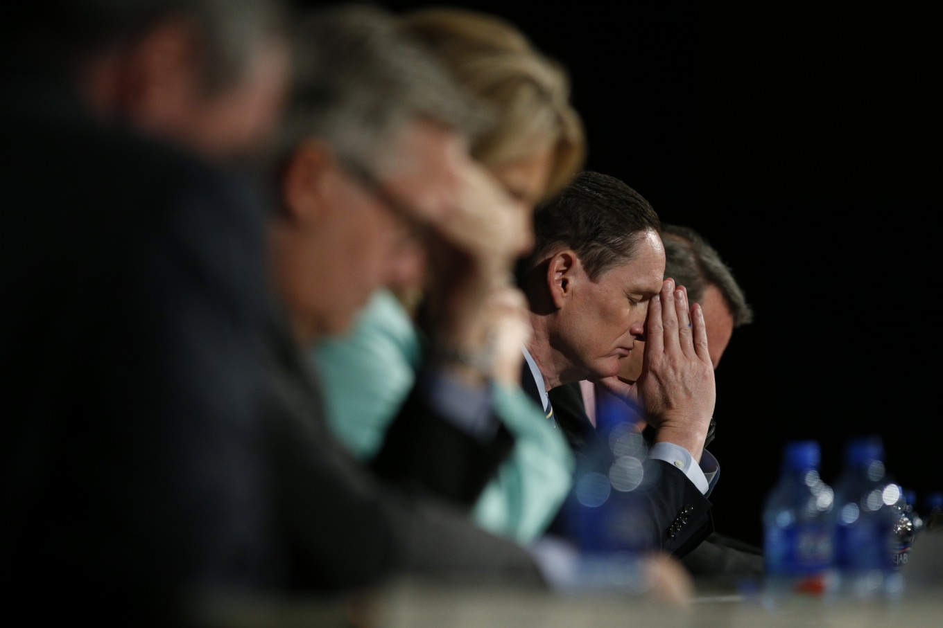 County Judge Clay Jenkins prays during a faith based organization meeting about the local response to the Ebola crisis at  Park Cities Baptist Church in Dallas October 29, 2014.  (Nathan Hunsinger/The Dallas Morning News)