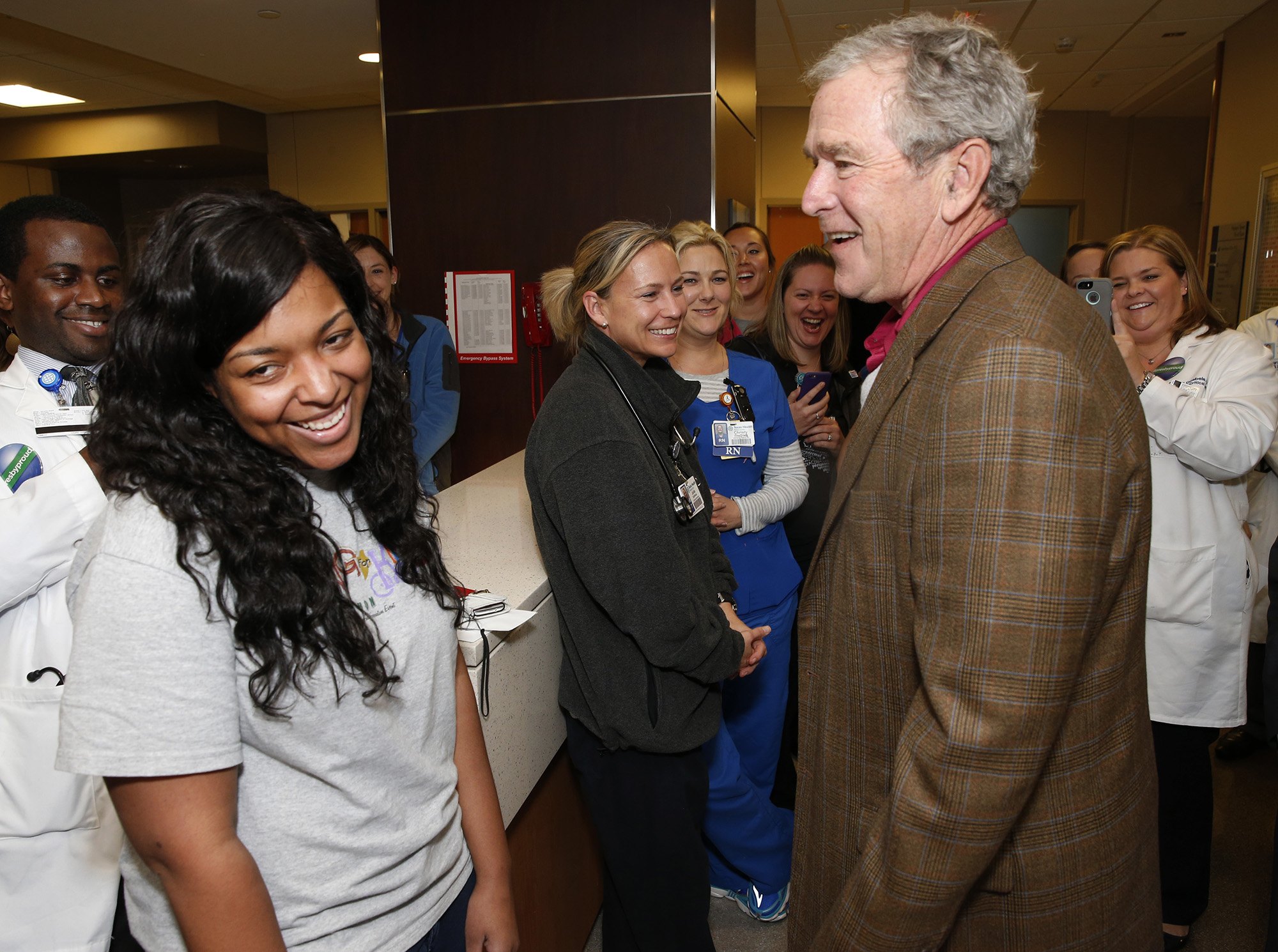 Amber Vinson, the nurse that had Ebola and is now Ebola free, got a hug and a kiss from Former President George W. Bush at Texas Health Presbyterian Hospital of Dallas on Friday, November 7, 2014 in recognition of the official end of the Ebola outbreak that started there in late September. (David Woo/The Dallas Morning News)