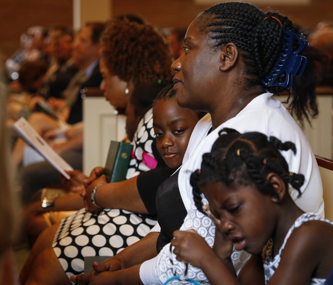 Louise Troh, center, the fiancée of Thomas Eric Duncan, sits with her granddaughters Rose Yah, left, 6, and Knowledge Dopoe, 5, at Wilshire Baptist Church in Dallas on Easter Sunday, April 5, 2015.  (Jim Tuttle/The Dallas Morning News)