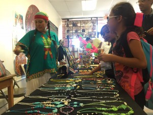 Ana Alvarez, who lives in Vickery Meadow, is one of several artists helped by Trans.lation, a project that allows vendors in Vickery Meadow to teach classes and sell art. Photo/Stella Chavez