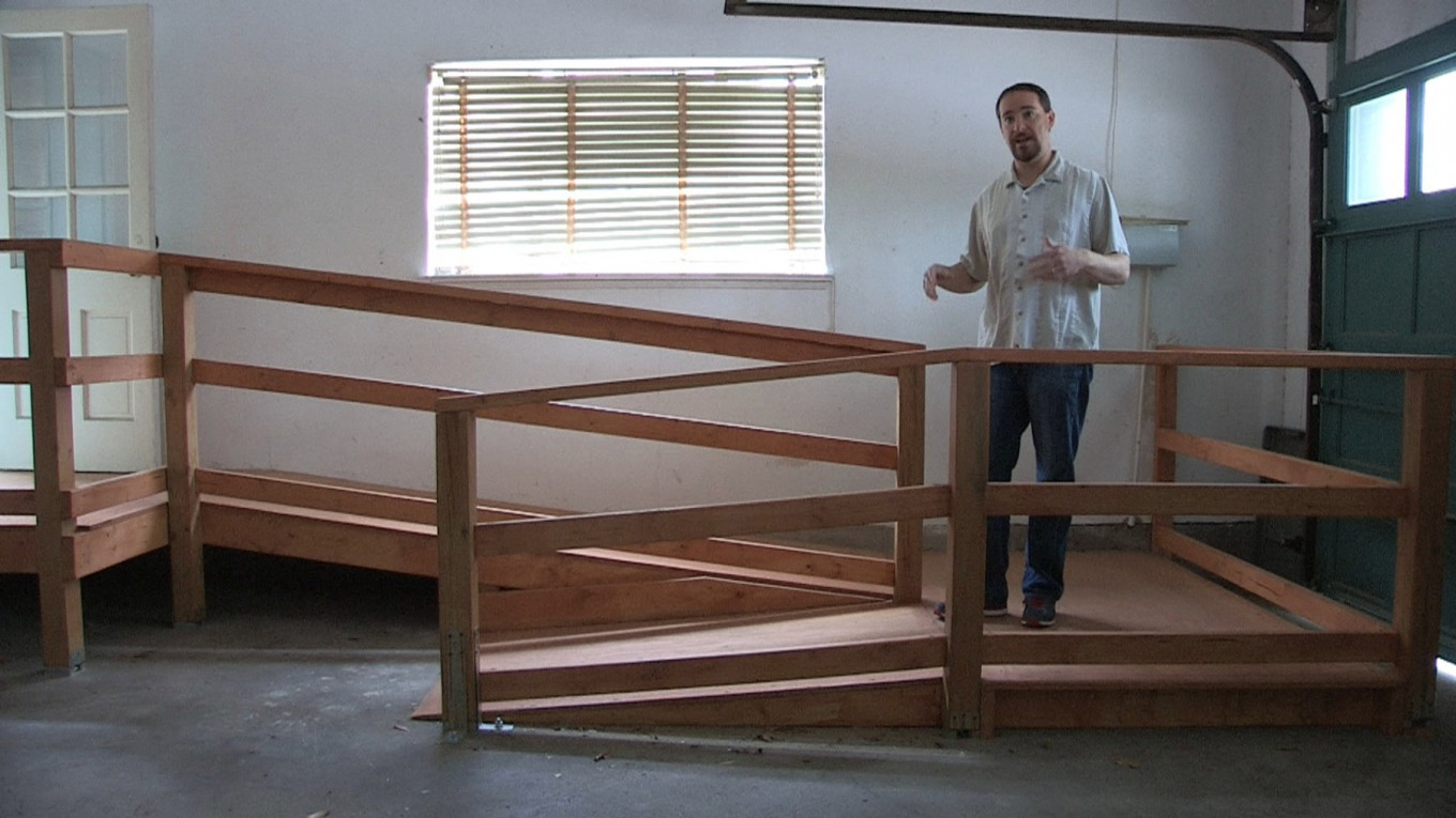 This 16-foot-long wooden ramp is designed with a specific slope that's easy for someone in a walker or wheelchair to maneuver.