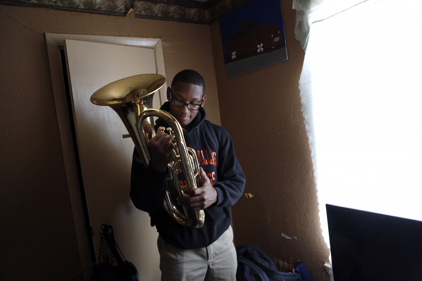 Desmond Davis, 18, admires his baritone, the instrument he plays in North Dallas High School's band. Photo/Lara Solt