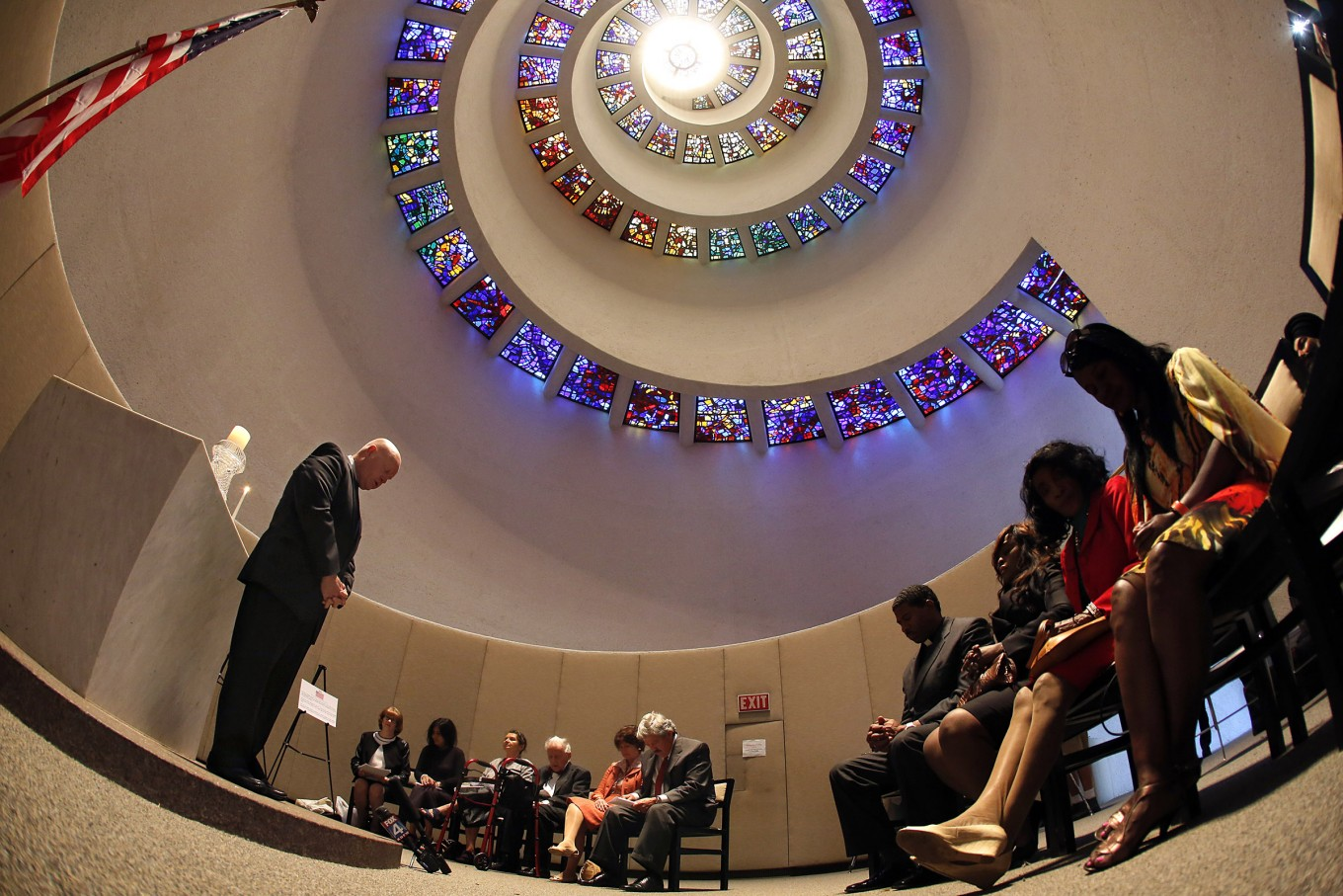 Mark Romney leads a small group prayer during a vigil in memory of those who have lost their lives to Ebola and the ones caring  for those infected, Thursday, October 23, 2014 at the chapel of Thanks-Giving Square.(Tom Fox/The Dallas Morning News)