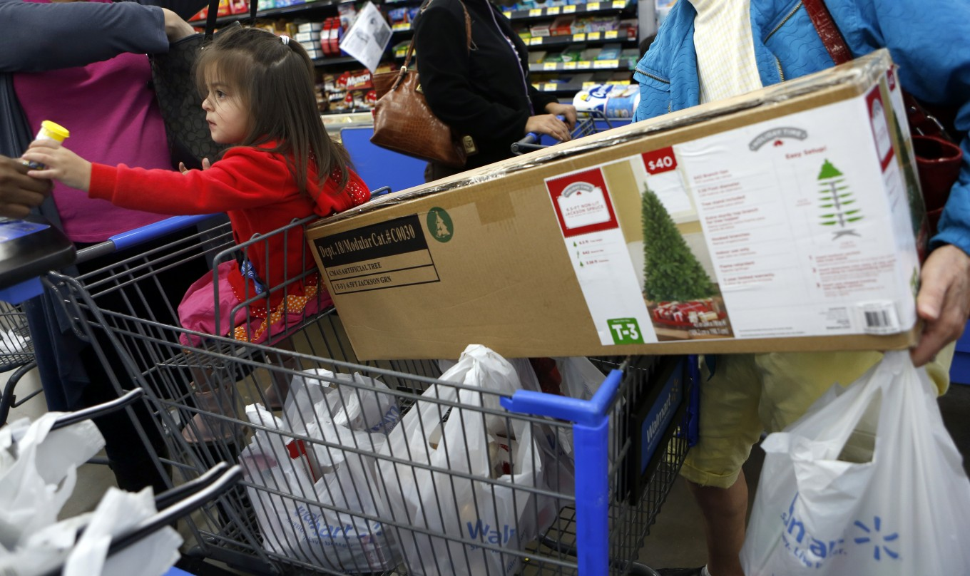 Abby Hernandez, 2, shopped with her mother and grandmother at Walmart in Dallas. Photo/Lara Solt
