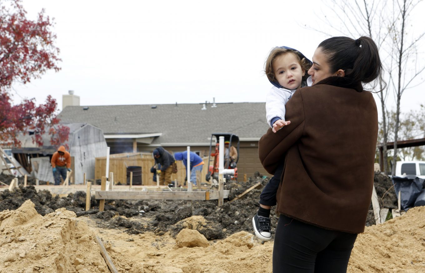 Lindsay Diaz and her son Arian at the lot in Rowlett where her duplex was mistakenly torn down. Photo/Lara Solt