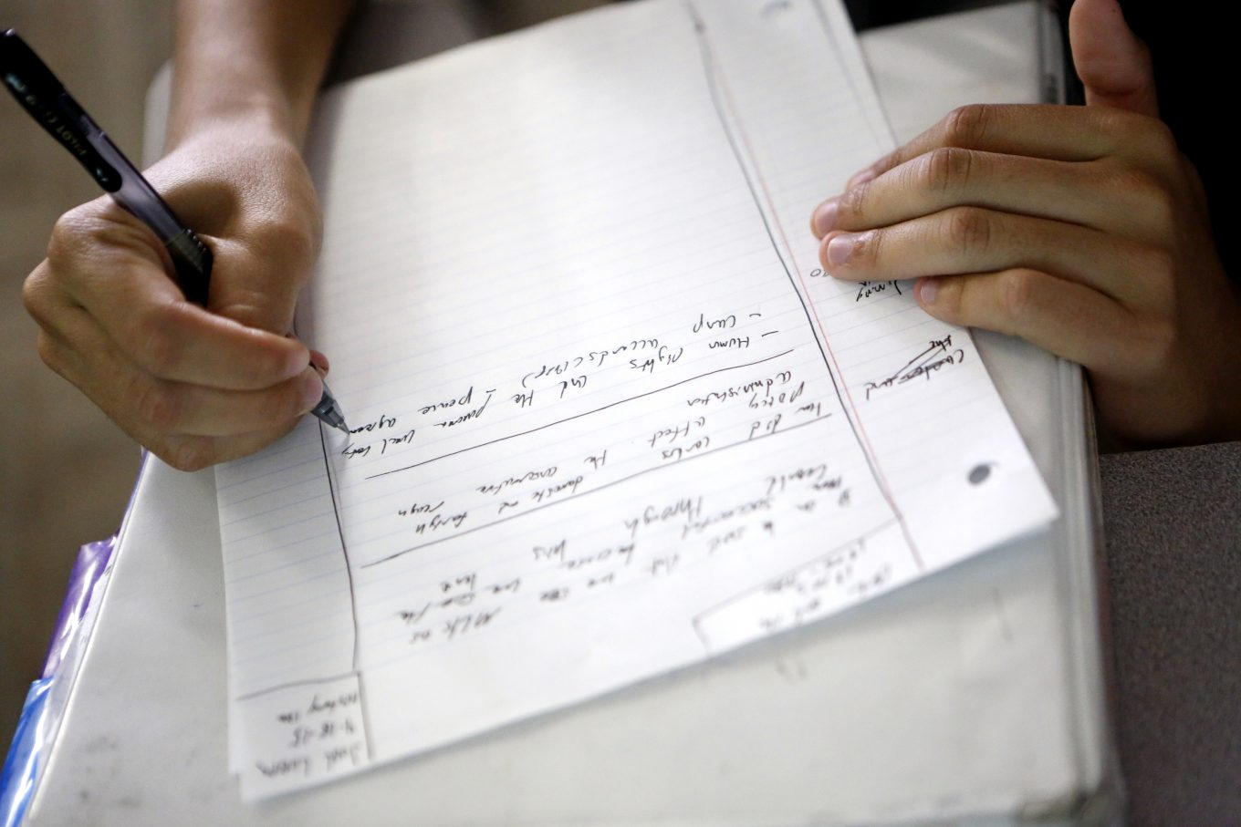 Joel Luera takes notes during a history lecture at Eastfield College in Mesquite. Photo/Lara Solt