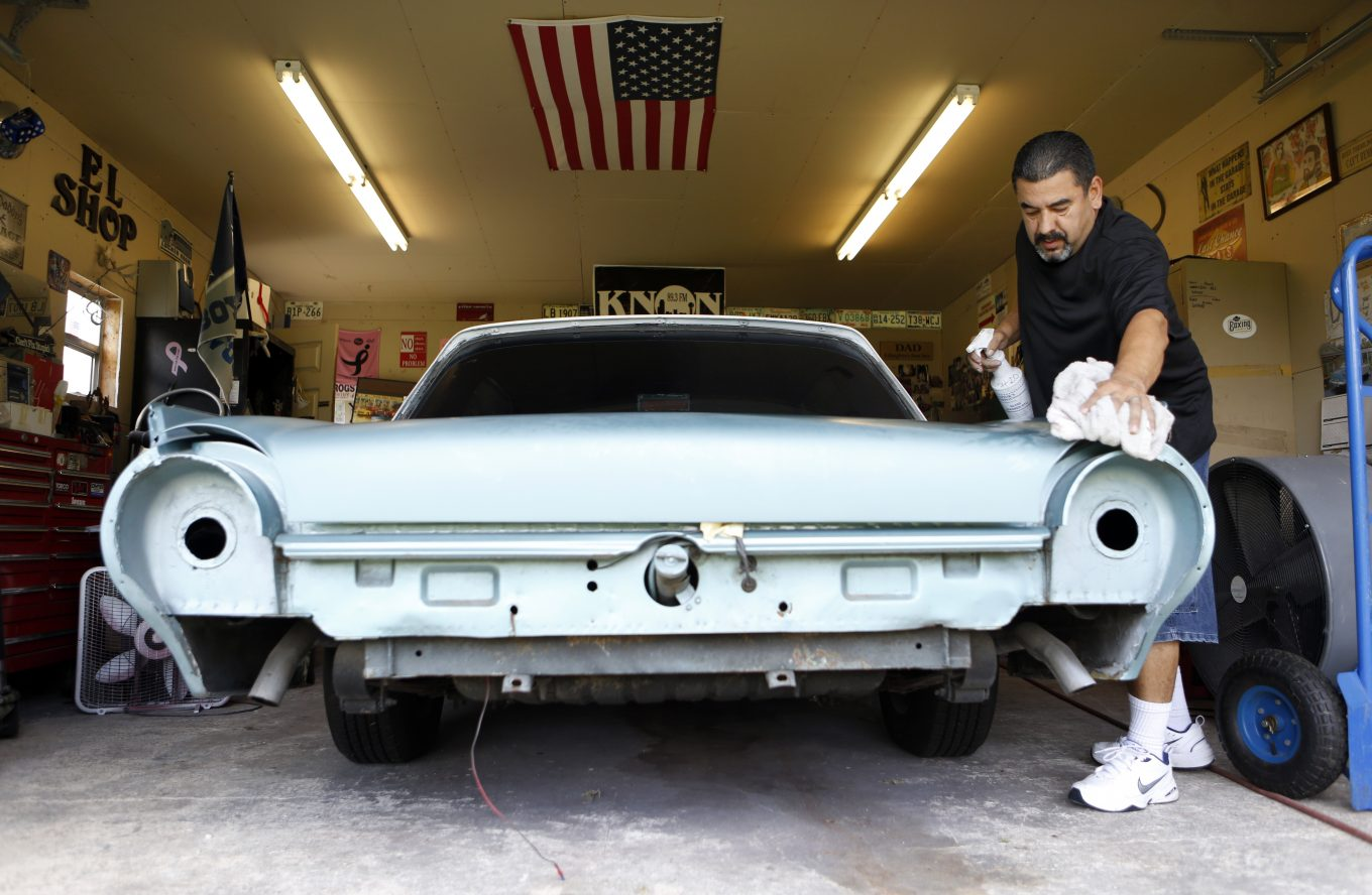 Rene Munguia restores a '62 Ford Thunderbird for a friend to make extra money. Photo/Lara Solt