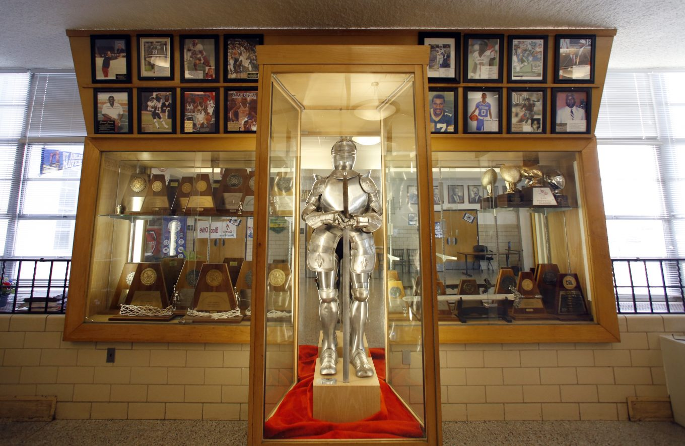 A knight, given to the school by the first graduating class, stands in the lobby at Kimball High in Dallas. Photo/Lara Solt