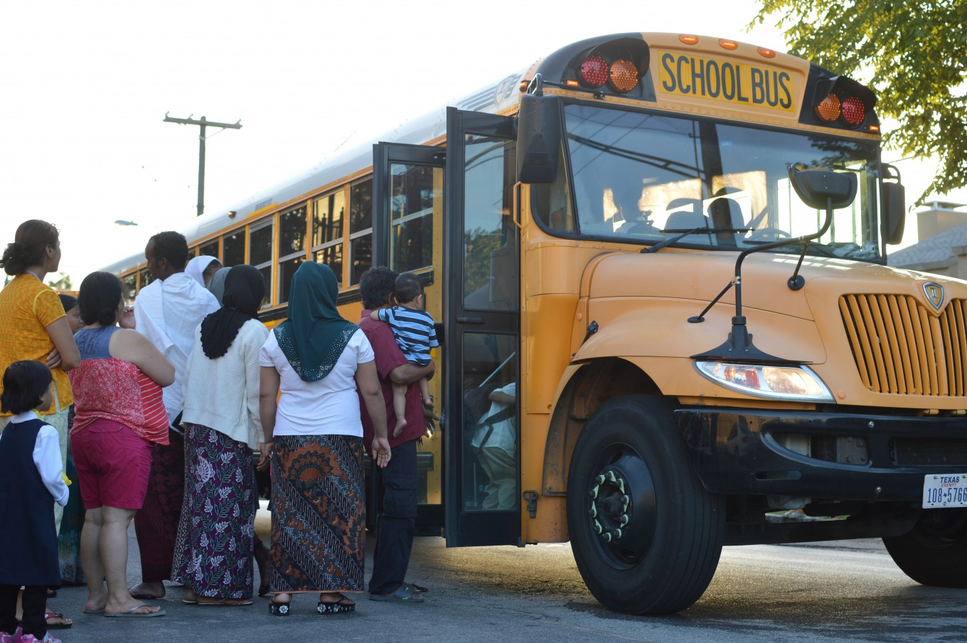 Kids and parents in Vickery Meadow in Dallas get ready for the first day of school. Photo/Christina Ulsh
