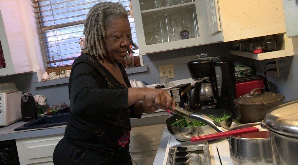 Shirley Martin cooking in her kitchen